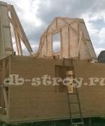 вид возводимого каркасного дома сбоку, проект деревянного дома ДБ-9